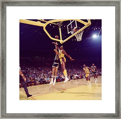 Kareem Abdul Jabbar Vs. Chamberlain Framed Print by Retro Images Archive
