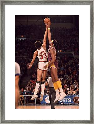 Kareem Abdul Jabbar Vs. Wilt Chamberlain Jump Ball Framed Print by Retro Images Archive