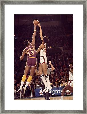 Kareem Abdul Jabbar Vs. Wilt Chamberlain Tip Off Framed Print by Retro Images Archive
