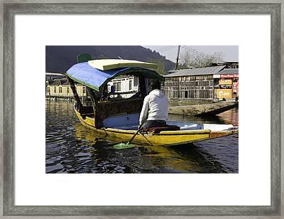 Kashmiri Man Driving This Shikara In The Still Waters Of The Dal Lake Framed Print by Ashish Agarwal