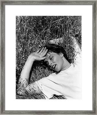 Katharine Hepburn Lying Down In The Grass Framed Print by George Hoyningen-Huene