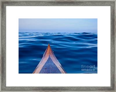 Kayak On Velvet Blue Framed Print by Michael Cinnamond