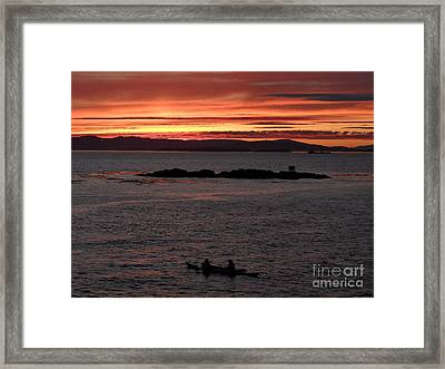 Kayak Sunset Framed Print by Gayle Swigart