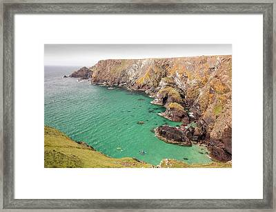 Kayakers In A Cove Near Mullion Cove Framed Print by Ashley Cooper