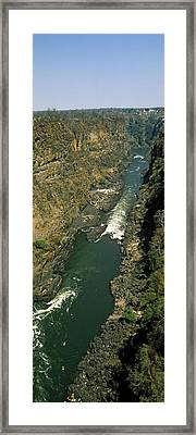 Kayakers Paddle Down The Zambezi Gorge Framed Print