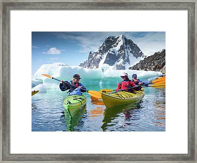 Kayaking Off Petermann Island Framed Print by Peter Menzel