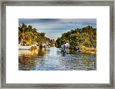 Kayaking The Canals Framed Print