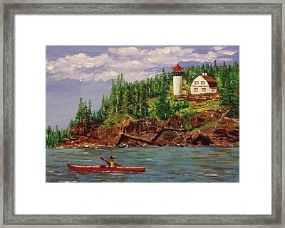 Kayaking The Coast Framed Print