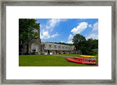 Kayaks At Boat House Framed Print