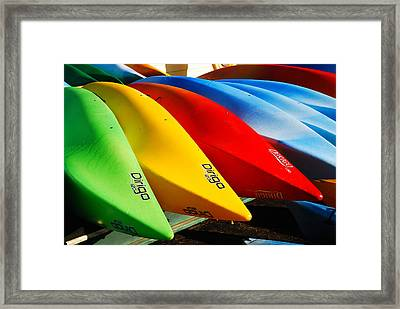 Kayaks Await Framed Print by James Kirkikis