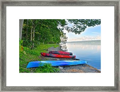 Kayaks Await Framed Print