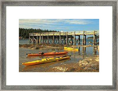 Kayaks By The Pier Framed Print by Adam Jewell