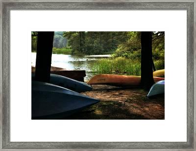 Kayaks On The Shore Framed Print