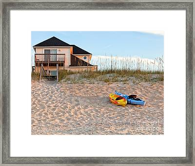 Kayaks Rest On Sand Dune In Morning Sun. Framed Print
