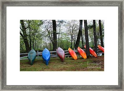 Kayaks Waiting Framed Print