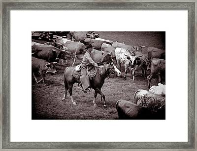 Keep Em Moving Framed Print