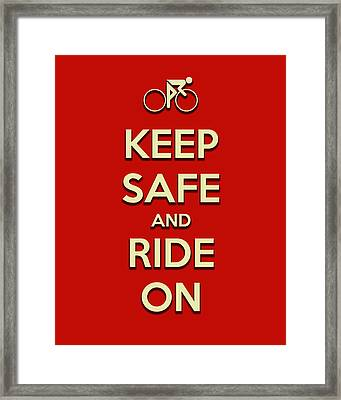 Keep Safe And Ride On Framed Print by Brian Carson
