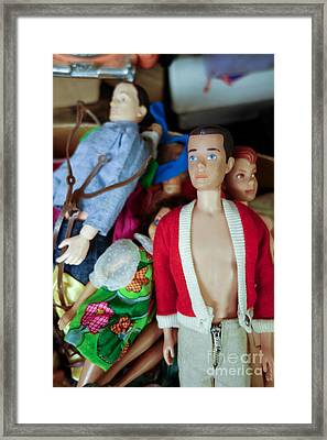 Ken Doll Amidst Other Vintage Barbie Dolls Framed Print by Amy Cicconi