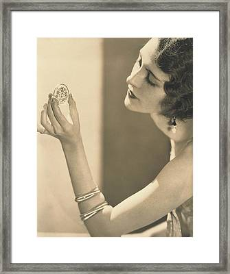 Kendall Lee Holding A Brooch Framed Print