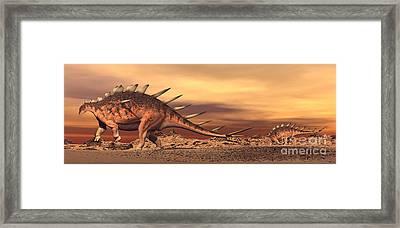 Kentrosaurus Mother And Baby Walking Framed Print