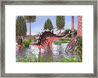Kentrosaurus Pair In Water Framed Print
