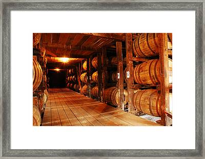 Kentucky Bourbon Aging In Barrels Framed Print by James Kirkikis