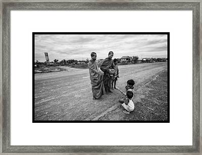 Khmer Rouge Monks Framed Print by David Longstreath