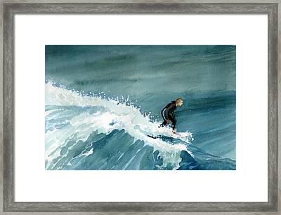 Kid Riding Wave Framed Print