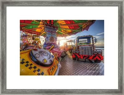 Kiddie Rides Framed Print by Yhun Suarez