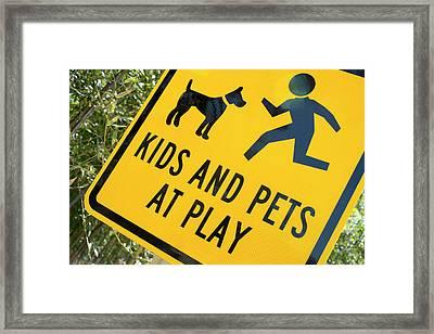 Kids And Pets At Play, Warning Sign Framed Print by Julien Mcroberts