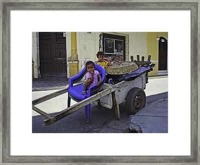 Kids In Wooden Wheel Barrel Framed Print by Camilla Fuchs