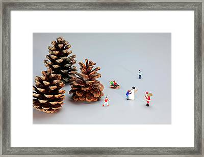 Kids Merry Christmas By Pinecones Framed Print by Paul Ge