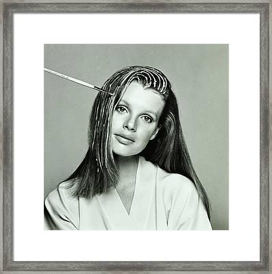 Kim Basinger Having Her Hair Highlighted Framed Print by Francesco Scavullo