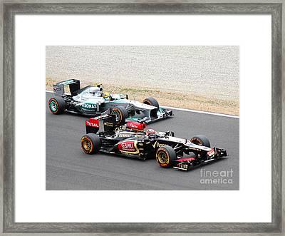 Kimi Raikkonen And Lewis Hamilton Framed Print