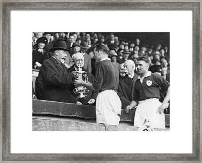 King Presents Soccer Trophy Framed Print by Underwood Archives