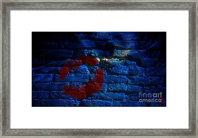 Kiss On A Brick Wall Framed Print