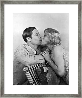 Kiss With Eyes Wide Open Framed Print by Underwood Archives