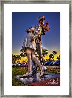 Kissing Sailor Framed Print by Marvin Spates