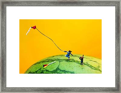 Kite Runner On Watermelon Framed Print by Paul Ge