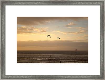 Kites At Sunset Framed Print by Dave Woodbridge