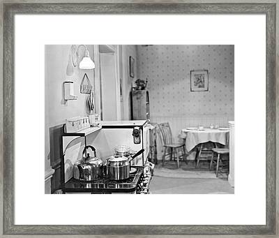 Kithchen With Pots And Pans Framed Print by Underwood Archives