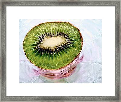 Kiwi Fruit On A Pink And Blue Glass Plate Framed Print