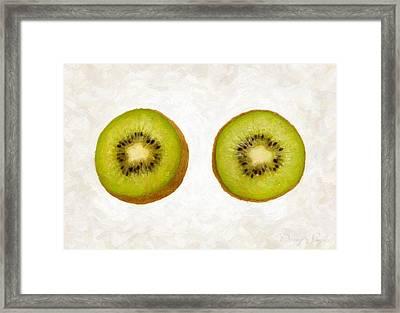 Kiwi Slices Framed Print by Danny Smythe
