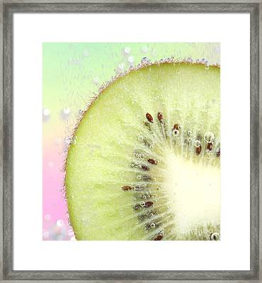Kiwi Splash Framed Print by Ruth Jolly