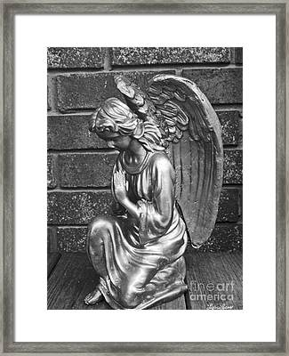 Kneeling Angel Framed Print