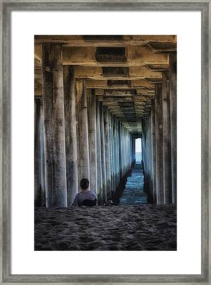 Knitter Under The Pier Framed Print