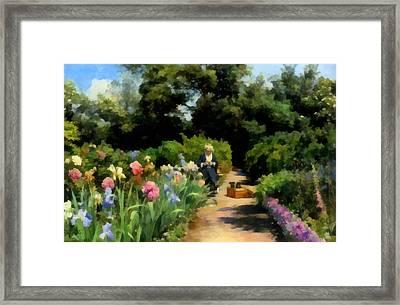 Knitting In The Garden Framed Print