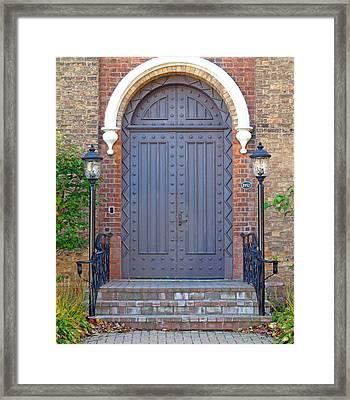 Knobby Door And Lamp Posts Framed Print by Barbara McDevitt