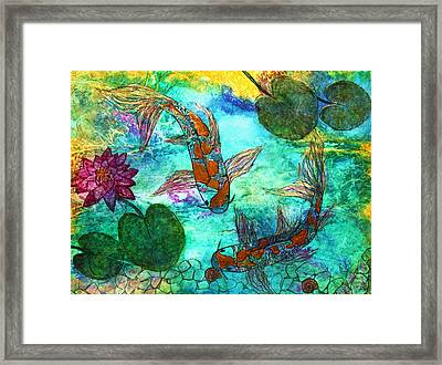 Koi Eating Apple Snails Framed Print