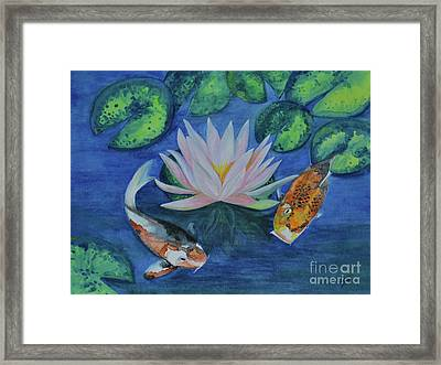Koi In The Lily Pond Framed Print